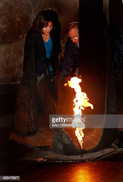 Anne Hidalgo Paris deputy mayor and Socialist Party candidate for the primary round of Paris municipal elections rekindles the eternal flame at the...