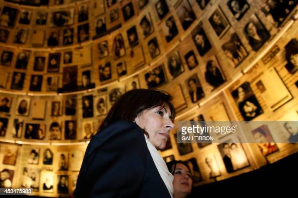 Anne Hidalgo Paris deputy mayor and Socialist Party candidate for the primary round of Paris municipal elections looks at pictures of Jewish...