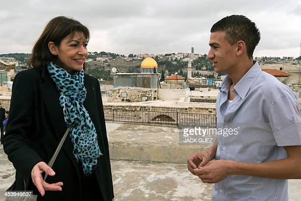 Anne Hidalgo Paris deputy mayor and Socialist Party candidate for the primary round of Paris municipal elections talks with a young Arab Israeli...