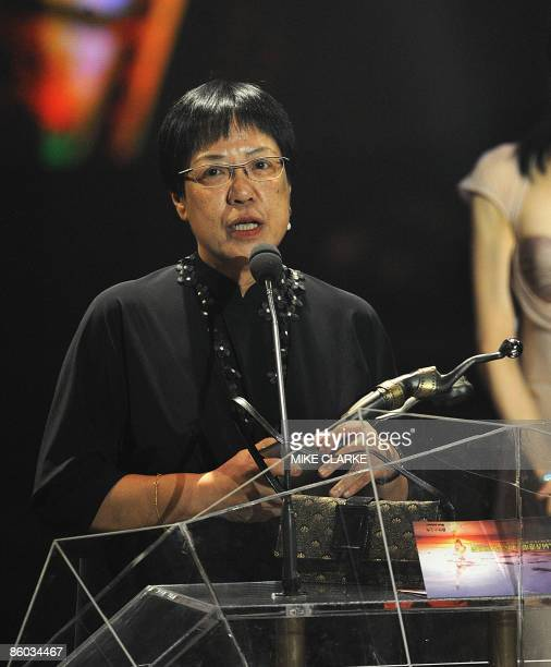 Anne Hui stands with the Best Director award at the Hong Kong Film Awards ceremony in Hong Kong on April 19 2009 The 28th Hong Kong Film Awards...
