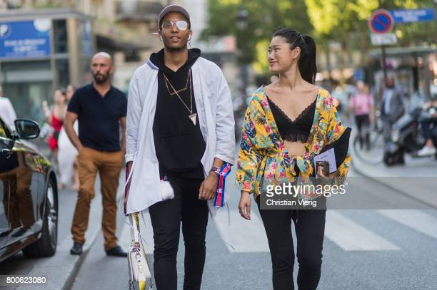 Anne Hui Zhan and Guest outside Hermes during Paris Fashion Week Menswear Spring/Summer 2018 Day Four on June 24 2017 in Paris France
