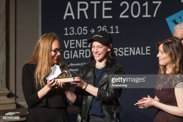 Anne Imhof, representing the German pavilion, and Susanne Pfeffer receive the Golden Lion for Best National Participation during the Opening Ceremony...