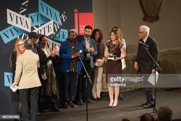 Anne Imhof, representing the German pavilion, receives from Maria Elena Boschi the Golden Lion for Best National Participation during the Opening...