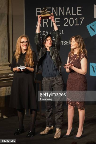 Anne Imhof shows the Golden Lion for Best National Participation during the Opening Ceremony of the 57th Biennale Arte on May 13, 2017 in Venice,...
