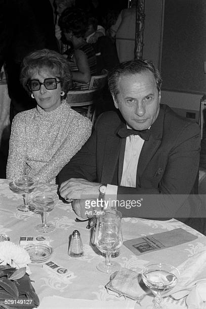 Anne Jackson with her his husband Eli Wallach at a formal dinner; circa 1970; New York.