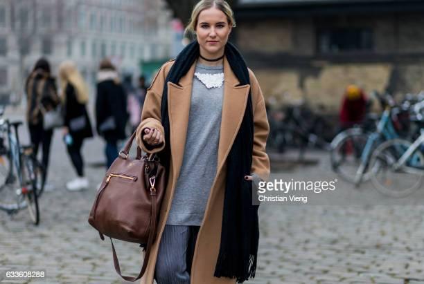 Anne Jaworski wearing a beige coat navy scarf grey pants grey longshirt brown Prada bag during the Copenhagen Fashion Week Autumn/Winter 17 on...