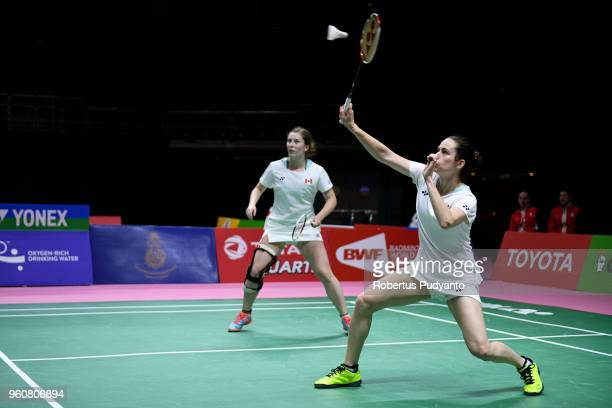 Anne Julie Beaulieu and Stephanie Pakenham of Canada compete against Shiho Tanaka and Koharu Yonemoto of Japan during Preliminary Round on day two of...