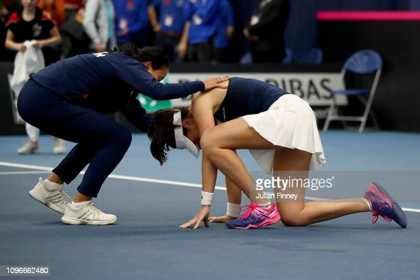 Anne Keothavong Great Britain Captain celebrates with Johanna Konta of Great Britain after victory in her promtional playoff match against Aleksandra...