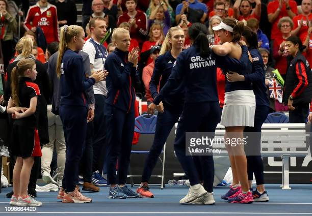 Anne Keothavong Great Britain Captain helps Johanna Konta of Great Britain as she collapses after victory in her promtional playoff match against...