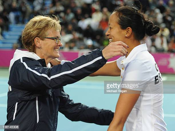 Anne Keothavong of Great Britain celebrates victory with GB captain Judy Murray after her match with Julia Glushko of Israel during the tie between...