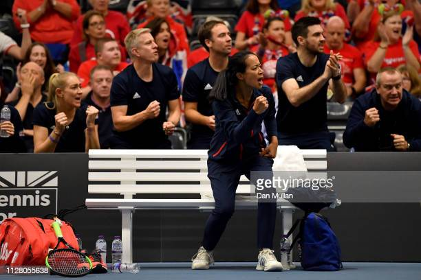 Anne Keothavong of Great Britain celebrates whilst watching Katie Boulter of Great Britain in action during her Europe/Africa Group A match against...