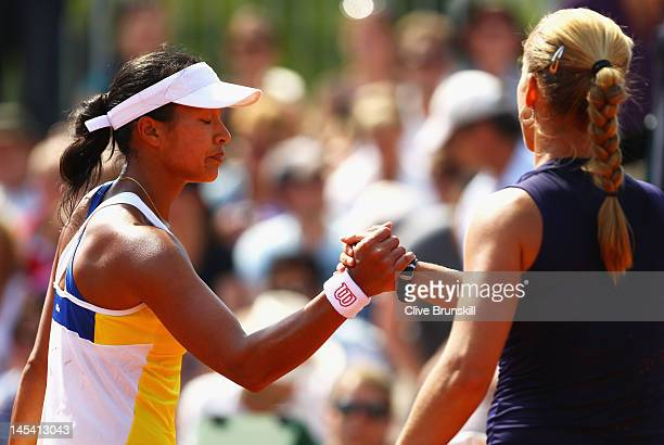 Anne Keothavong of Great Britain looks dejected as she shakes hands with Melinda Czink of Hungary after their women's singles first round match...