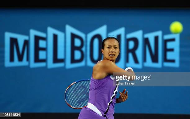 Anne Keothavong of Great Britain plays a backhand in her second round match against Andrea Petkovic of Germany during day three of the 2011...