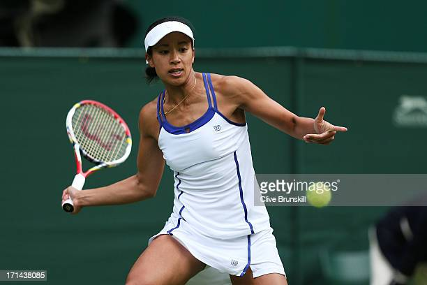 Anne Keothavong of Great Britain plays a forehand in her Ladies' Singles first round match against Garbine Muguruza of Spain on day one of the...