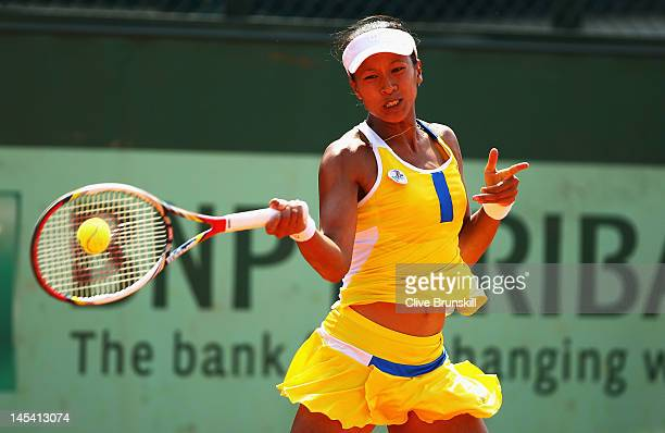 Anne Keothavong of Great Britain plays a forehand in her women's singles first round match between Anne Keothavong of Great Britain and Melinda Czink...