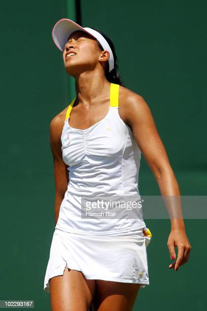Anne Keothavong of Great Britain reacts during her first round match against Anastasia Rodionova of Australia on Day Two of the Wimbledon Lawn Tennis...