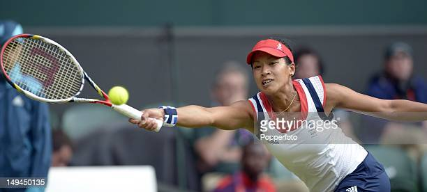 Anne Keothavong of Great Britain returns a shot against Caroline Wozniacki of Denmark during their Women's Singles Tennis match on Day 1 of the...