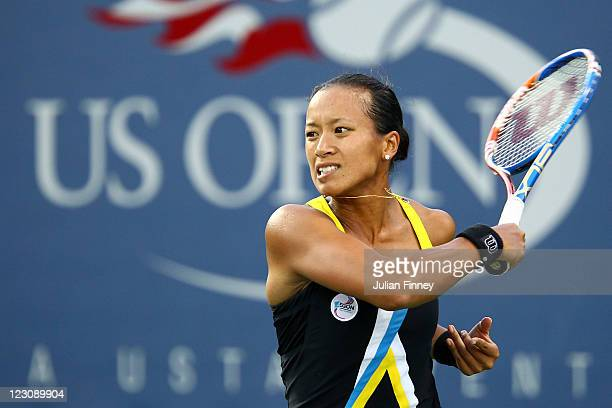 Anne Keothavong of Great Britain returns a shot against Chanelle Scheepers of South Africa during Day Two of the 2011 US Open at the USTA Billie Jean...