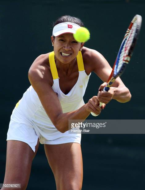 Anne Keothavong of Great Britain returns a shot during her first round match against Anastasia Rodionova of Australia on Day Two of the Wimbledon...