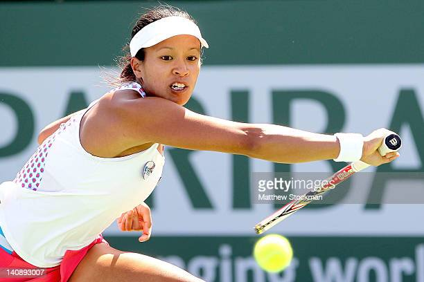 Anne Keothavong of Great Britain returns a shot to Timea Bacsinsky of Switzerland during the BNP Paribas Open at the Indian Wells Tennis Garden on...