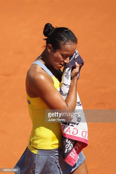 Anne Keothavong of Great Britain shows her dejection during the women's singles first round match between Flavia Pennetta of Italy and Anne...