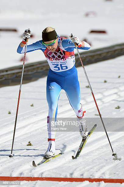 Anne Kylloenen of Finland crosses the finish line in the Women's 10 km Classic during day six of the Sochi 2014 Winter Olympics at Laura Crosscountry...