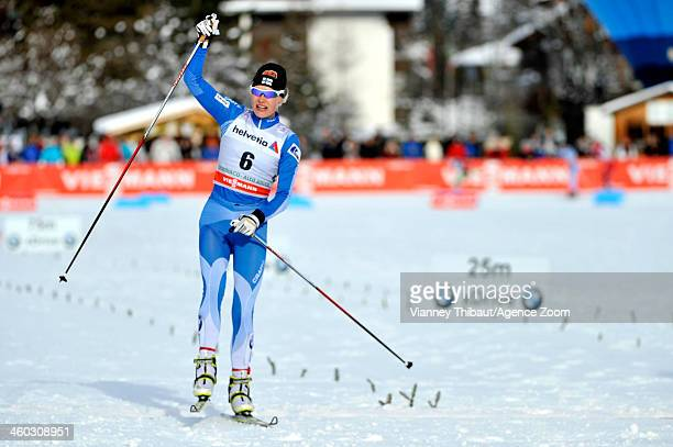 Anne Kylloenen of Finland takes 3rd place during the FIS CrossCountry World Cup Tour de Ski Women's Pursuit on January 03 2014 in CortinaToblach Italy