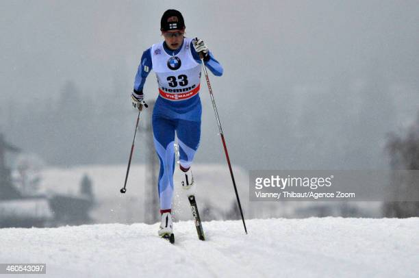 Anne Kylloenen of Finland takes 3rd place during the FIS CrossCountry World Cup Tour de Ski Women's 5km on January 04 2014 in Val di Fiemme Italy