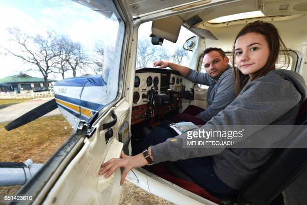 Anne Labbe France's youngest private airplane pilot sits next to her instructor Emmanuel Deporte into the cockpit of a Cessna 152 before takingoff on...