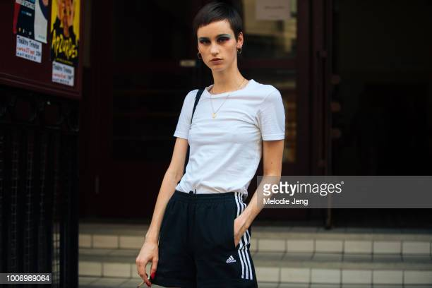 Anne Lalaich in colorful rainbow eye makeup after the Romance Was Born show and a white tshirt and Adidas pants during Couture Fall/Winter 2018...