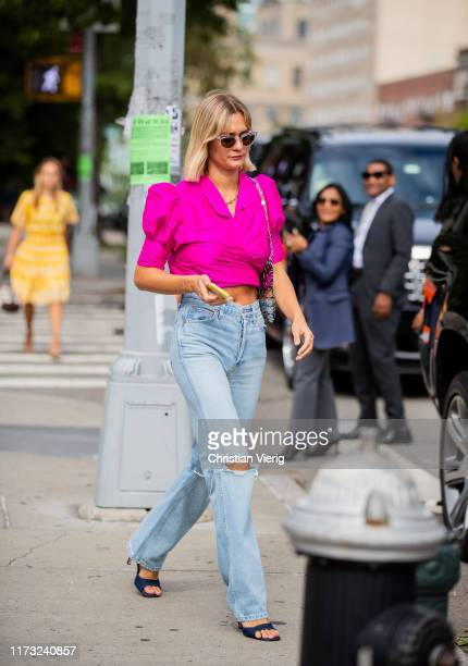 Anne Laura Mais is seen wearing ripped denim jeans pink top outside Tory Burch during New York Fashion Week September 2019 on September 08 2019 in...
