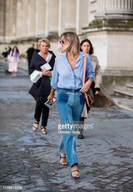Anne Laure Mais seen wearing two tone denim jeans blue button shirt outside Louis Vuitton during Paris Fashion Week Womenswear Spring Summer 2020 on...