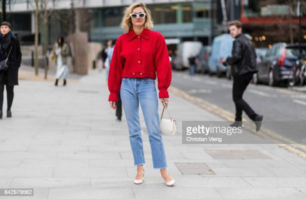 Anne Laure Mais wearing a red jacket denim jeans outside Topshop Unique on day 3 of the London Fashion Week February 2017 collections on February 19...