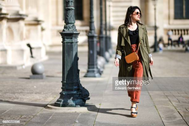 Anne Laure SasMayaux from the blog L'Atelier d'Al wears a Zara green trench Mango orange pants a Lancel bag Nice Thing shoes Izipitzi sunglasses at...
