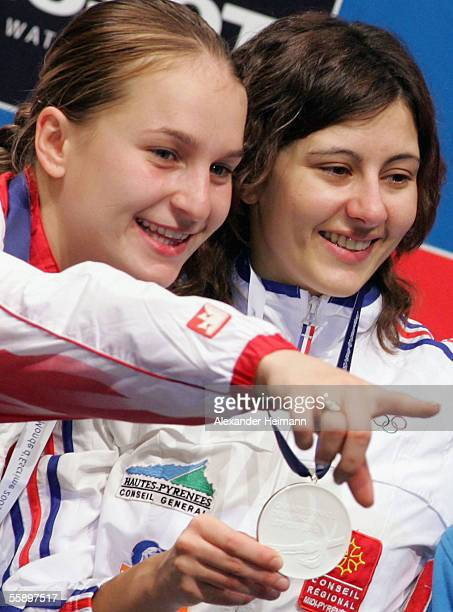 Anne Lise Toya of France and Sophia Velikaia of Russia celebrate their victory during the winners ceremony of the women's sabre final during the day...