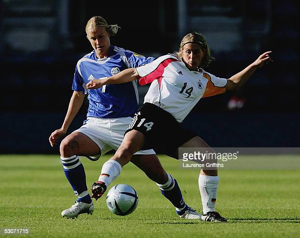 Anne Makinen of Finland battles for the ball with Britta Carlson of Germany during UEFA Women's Europen Championship Semi Fianal match between...