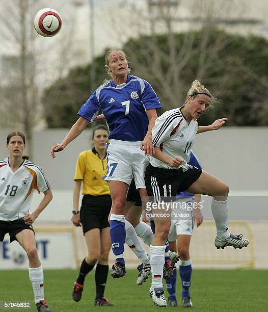 Anne Makinen of Finland fights for the ball with Anja Mittag of Germany during the Womens Algarve Cup match between Germany and Finland on March 9,...