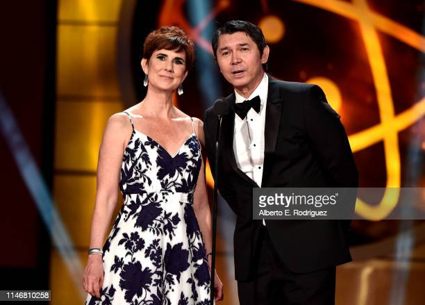 Anne Marie Cumming and Lou Diamond Phillips speak onstage during the 46th annual Daytime Creative Arts Emmy Awards at Pasadena Civic Center on May 03...