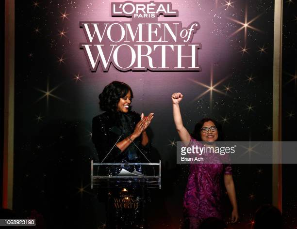Anne Marie NelsonBogle claps for honoree Shandra Woworuntu onstage at the L'Oréal Paris Women of Worth Celebration at The Pierre Hotel on December 5...
