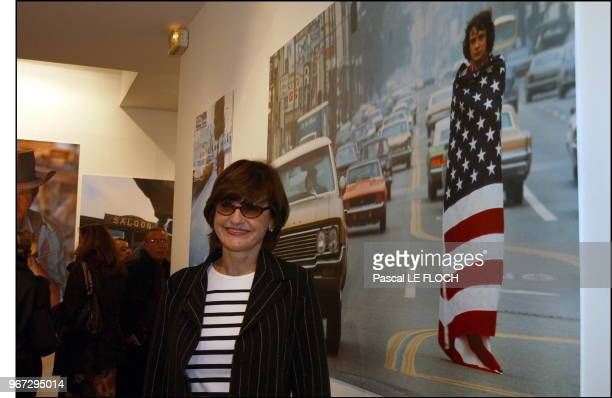 Anne Marie Perier in front of the Michel Sardou picture