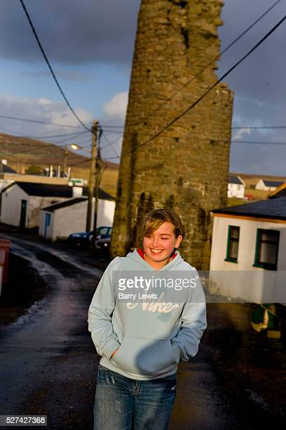 Anne Marie Rogers in front of the Round tower West Town Tory Island nine miles off the Donegal coast NorthWest Ireland This remote island two and a...