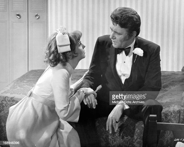 Anne Meara pleads with Harry Guardino in a scene from the film 'Lovers And Other Strangers', 1970.