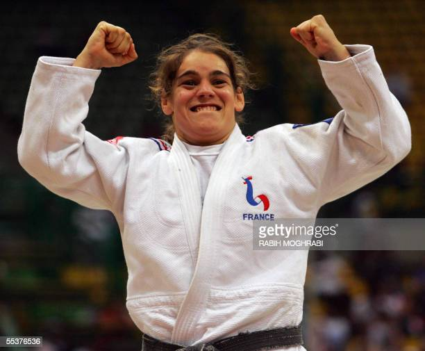 Anne Mondiere of France jubilates after winning the gold medal in the open women class at the World Judo Championships in Cairo 11 September 2005 AFP...