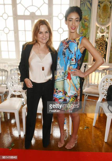Anne Mondy and a model dressed by Veronique Fournier attend 'Fashion Night Couture' 8th Edition at Galerie de Miroirs on April 25 2018 in Paris France
