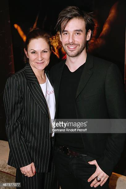 Anne Mondy and Arthur Aubert attend his Exhibition private view Held at Le Fouquet's Barriere Hotel on February 6 2014 in Paris France