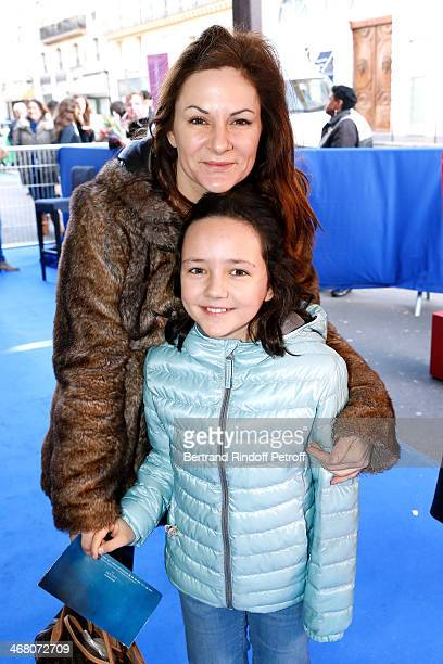 Anne Mondy and her daughter attend 'La Belle et la Bete' Paris Premiere Held at Gaumont Opera on February 9 2014 in Paris France