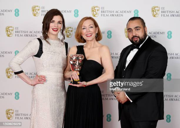 Anne Morgan with the Best Make Up and Hair award with Aisling Bea and Asim Chaudhry pose in the Winners Room during the EE British Academy Film...