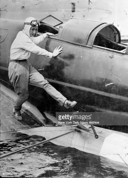 Anne Morrow Lindbergh boards monoplane for flight to Asia