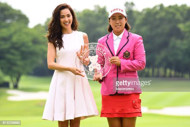 Anne Nakamura of Japan and HaeRym Kim of South Korea pose with the trophy after winning the Samantha Thavasa Girls Collection Ladies Tournament at...