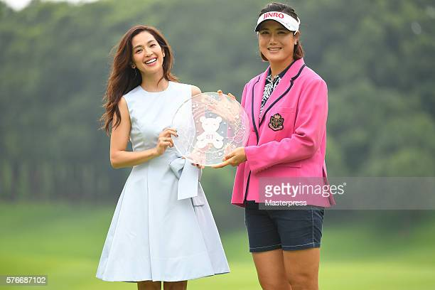 Anne Nakamura of Japan and MiJeong Jeon of South Korea pose during award ceremony for the Samantha Thavasa Girls Collection Ladies Tournament 2016 at...